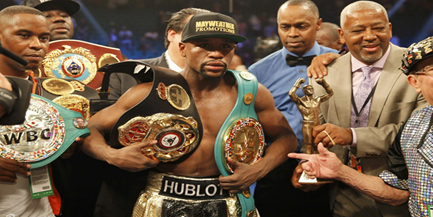 Mayweather vence a Pacquiao en combate del siglo