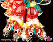 El zapato de cabeza de tigre y su buen augurio