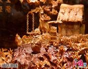 Enciclopedia de la cultura china: Escultura en canarium de Guangzhou