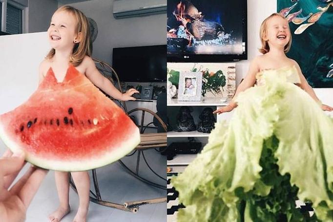 Adorable niña decorada con frutas y verduras
