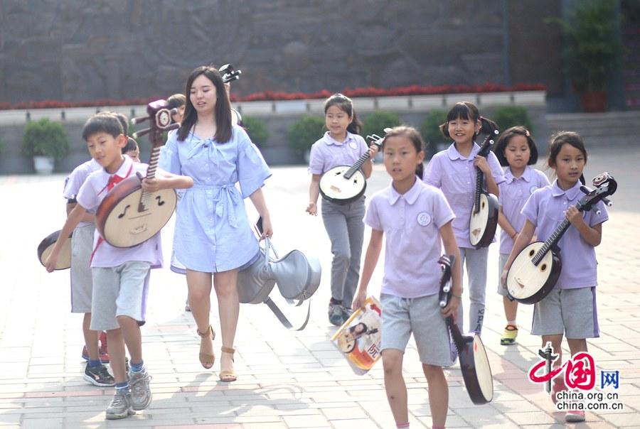 El futuro de la música folklórica china radica en los niños