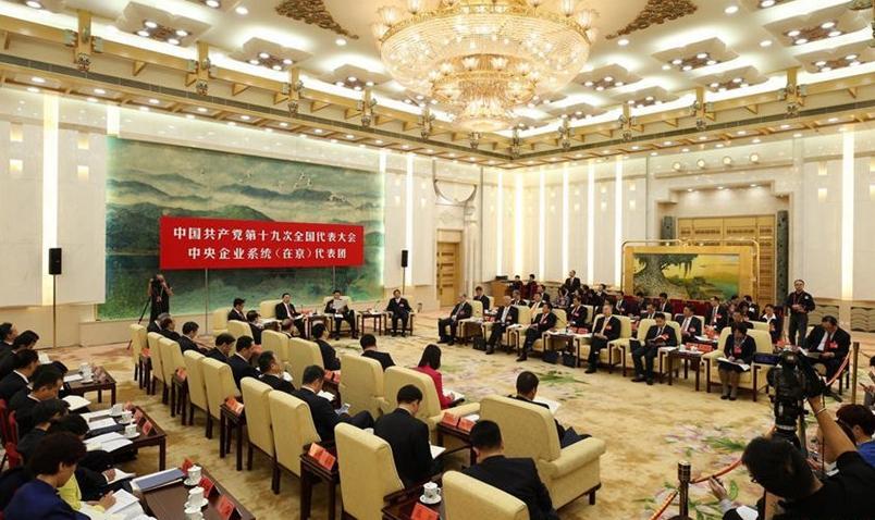 Delegados discuten el informe del XIX Congreso Nacional del PCCh