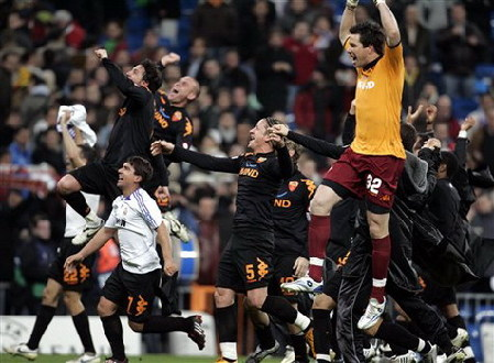 AS Roma's players celebrate at the end of the Champions League second round soccer match between Real Madrid and AS Roma in Madrid yesterday. Roma won 2-1.