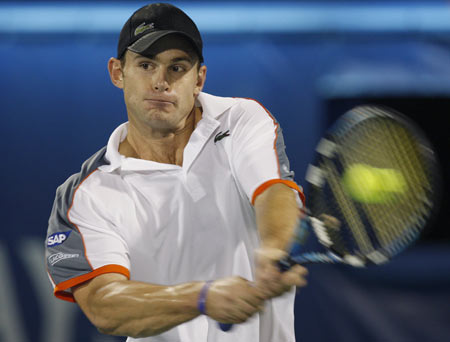 Andy Roddick of the U.S. returns the ball to Spain's Rafael Nadal during their quarter-final match at the ATP Dubai Tennis Championships March 6, 2008.
