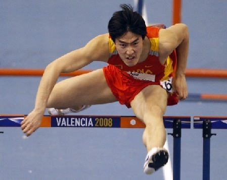 China's Liu Xiang competes to win the men's 60m hurdles final at the 12th IAAF World Indoor Athletics Championship in Valencia March 8, 2008. 