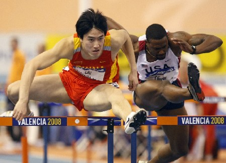 China's Liu Xiang (L) and David Oliver of the U.S. compete in the men's 60m hurdles semi-final at the 12th IAAF World Indoor Athletics Championship in Valencia March 8, 2008. 