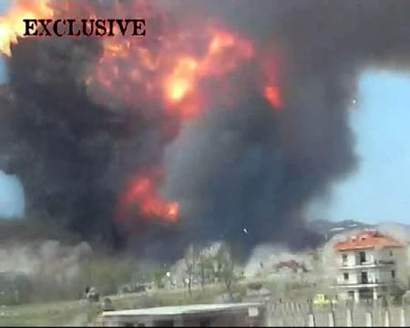 A TV grab image of the chain explosions of an Albanian ammunition dump on March 16, 2008. At least nine people were killed, 240 injured, in the chain explosions of an Albanian ammunition dump near the capital Tirana on March 15.