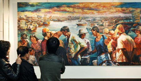 Visitors view the paintings at the painting exhibition of artists from the Democratic People's Republic of Korea (DPRK) held in Dalian, a coastal city in northeast China's Liaoning province, March 16, 2008.