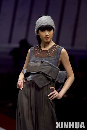 "A model presents creation during the 2008/2009 China Fashion Week (A/W) Collections and ""Hempel Award""the 16th International Young Fashion Designer Contest in Beijing, capital of China, March 25, 2008."