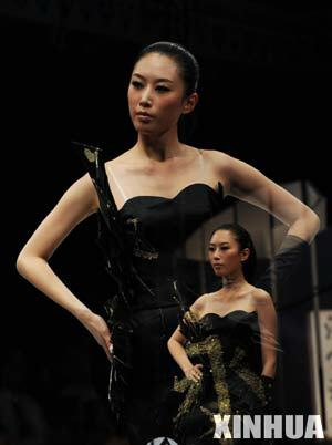 Multi-exposure photo taken on March 25, 2008 shows a model presenting a creation during the first day of 2008/2009 China Fashion Week (A/W) Collections in Beijing, capital of China.