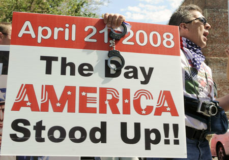 Protesters demonstrate as U.S. President George W. Bush arrives for the North American Leaders' Summit in New Orleans, Louisiana on April 21, 2008.