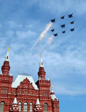 Russian military planes fly above the Historical Museum in Red Square during a Victory Day military parade in Moscow May 9, 2008. Warplanes screamed over Red Square and missile launchers rumbled past ranks of soldiers on Friday when Russia celebrated victory over Nazi Germany with a show of military might not seen since the collapse of the Soviet Union.