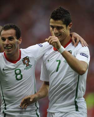 Portugal's Cristiano Ronaldo (R) celebrates his goal during the Euro 2008 Group A football match against Czech Republic in Geneva, Switzerland, June 11, 2008. Portugal won 3-1.