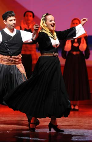 Performers from the Greek troupe Dora Strotou play the folk dance during the China Xinjiang International Folk Dance Festival in Urumqi, capital of northwest China's Xinjiang Uygur Autonomous Region, June 14, 2008.