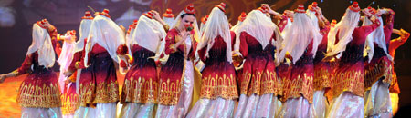 Dancers perform during the closure of the first China Xinjiang International Folk Dance Festival in Urumqi, capital of northwest China's Xinjiang Uygur Autonomous Region, June 18, 2008. The 10-day festival attracted dancers and terpsichoreans from both China and other countries including Russia, Egypt, Mexico, Greece, India and the Democratic People's Republic of Korea.