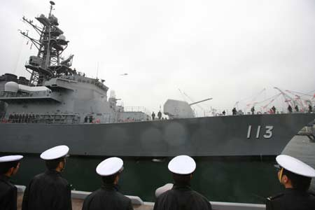 Soldiers of the Japanese Maritime Self-Defense Force (MSDF) see off the destroyer