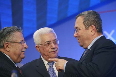 Iraq President Jalal Talabani (L), Palestinian President Mahmoud Abbas (C) and Israel's Defence Minister Ehud Barak talk during a Socialist International congress in Lagonisi July 1, 2008. The three-day congress discusses climate change, peace and the resolution of conflicts, the world economy and migration.