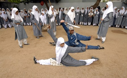 Wushu trainer Rahman Aqeel (C) instructs during Chinese wushu martial arts practice at St. Maaz high school, in the southern Indian city of Hyderabad July 8, 2008. Girls from ages 10 to 16 participate in weekly sessions during school term.