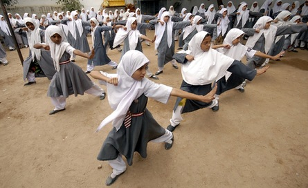 Muslim schoolgirls from St. Maaz high school practise Chinese wushu martial arts inside the school compound in the southern Indian city of Hyderabad July 8, 2008.