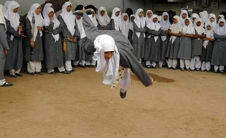 A Muslim schoolgirl from St. Maaz high school practises Chinese wushu martial arts inside the school compound in the southern Indian city of Hyderabad July 8, 2008.