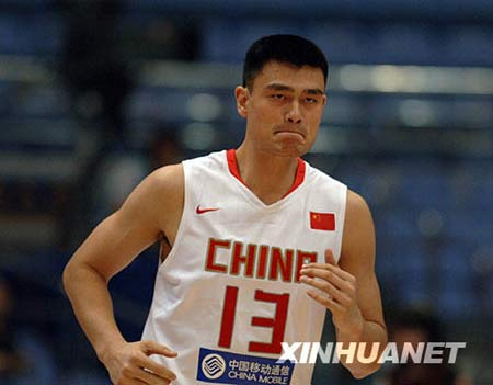 Chinese basketball star Yao Ming, 2.28m Houston Rockets center, plays during the match against Serbia at the Stankovic Cup basketball Olympic warmup tournament in Hangzhou, capital of east China's Zhejiang Province, July, 17, 2008.