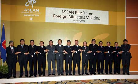 Foreign Ministers and representatives to the Association of Southeast Asian Nations (ASEAN) plus three foreign ministers meeting hold hands during the meeting in Singapore July 22, 2008. Foreign ministers from the ASEAN countries and China, Japan and South Korea attended the meeting here on Tuesday.
