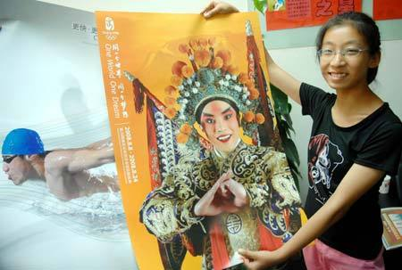 A girl displays her newly-bought Beijing Olympic Games poster in Beijing July 26, 2008.