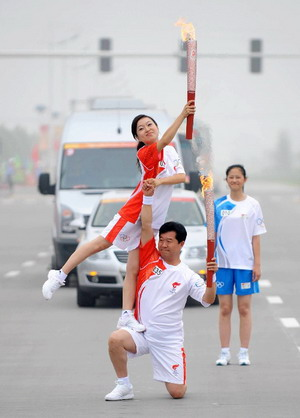 Photo: Torchbearers strike a pose
