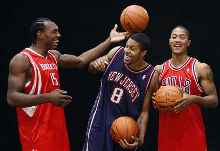 2141fe6e02e Former University of Memphis players and now NBA rookies (R-L) Derrick Rose  of the