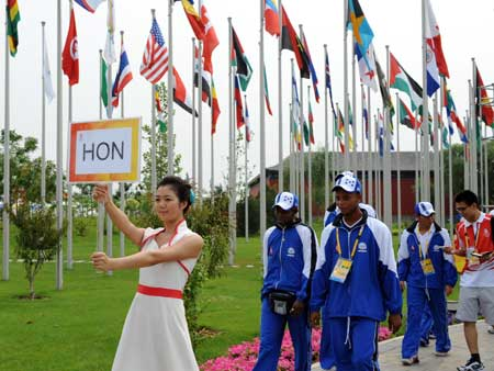 Members of the Honduran delegation to the Beijing 2008 Olympic Games step into the ceremony plaza for flag-raising at Olympic Village in Beijing, China, July 30, 2008. The delegation held flag-raising ceremony at Olympic Village on Wednesday morning. (Xinhua/Yang Lei)