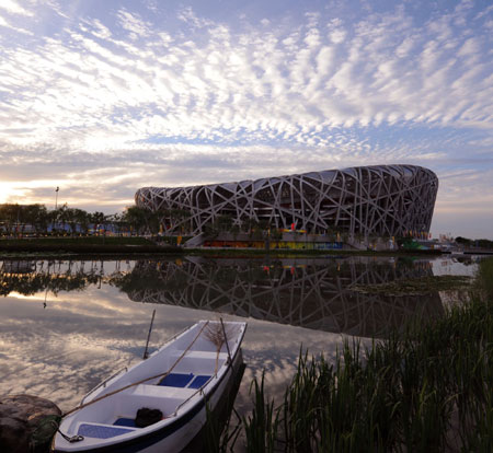 The National Stadium, also known as the Bird's Nest, is seen over a man-made lake at the Olympic Green, against the backdrop of the blue sky in Beijing, August 1, 2008.