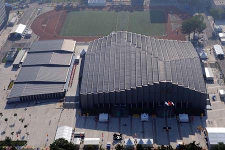 The aerial photo taken on August 2, 2008 shows the China Agricultural University Gymnasium in Beijing, China. The wrestling competition of the Beijing 2008 Olympic Games will be held there. (Xinhua/Guo Dayue)