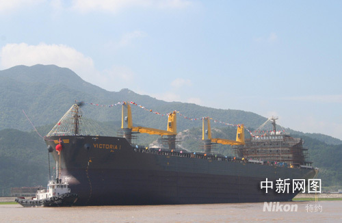 An ocean bulk cargo ship with capacity of 55,000 tons is launched in Taizhou in eastern China's Zhejiang province on Sunday, August 3, 2008.