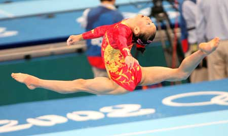 Chinese gymnast Yang Yilin practices floor exercise at the National Indoor Stadium in Beijing, China, Aug. 7, 2008. The Chinese women's gymnastics team held a training session here Thursday, preparing for the upcoming Beijing Olympics. [Xinhua]