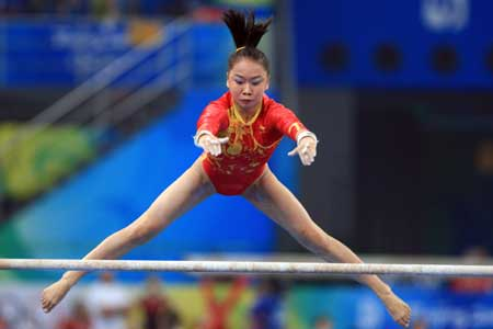 Chinese gymnast Li Shanshan practices uneven bars at the National Indoor Stadium in Beijing, China, Aug. 7, 2008. [Xinhua]