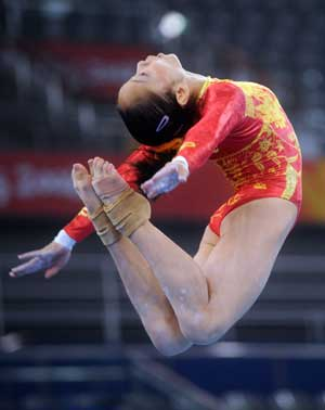 Chinese gymnast Deng Linlin practices balance beam at the National Indoor Stadium in Beijing, China, Aug. 7, 2008. [Xinhua]
