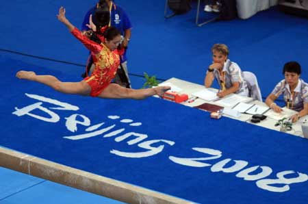 Chinese gymnast Cheng Fei practices balance beam at the National Indoor Stadium in Beijing, China, Aug. 7, 2008.