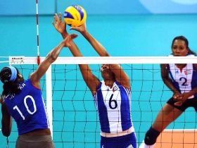 Head coach of Cuban women's volleyball team is observing his team's performance in a pre-Olympic warm up training. Cuban women volleyball team is a powerful candiate for the gold, and the principal rival for team China.