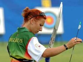 Olympic archers from Columbia and Belarus are making adaptation training and test in the archery field of Bejing Olympic Park on July 31
