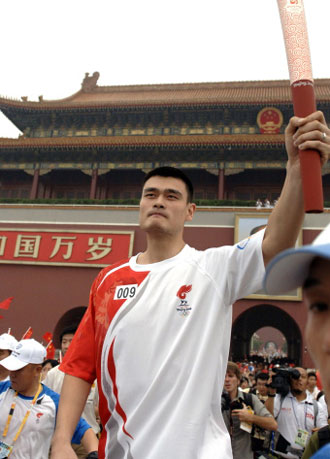 Yao Ming, Chinese NBA basketball star, will carry the Chinese national flag at the opening ceremony of the Beijing Olympic Games. Yao carried the flag four years ago in Athens. [Xinhua]