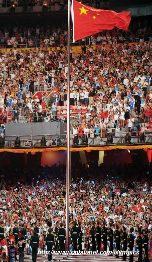 Chinese national flag is hoisted aloft during the opening ceremony of the Beijing Olympic Games held in the National Stadium, also known as the Bird's Nest, in north Beijing, China, Aug. 8, 2008. [Li Ga/Xinhua]