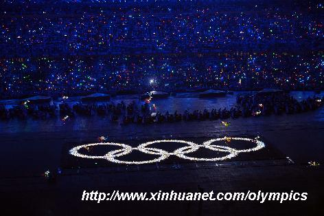 Photo taken on Aug. 8, 2008 shows the shining Olympic rings on a huge LED screen, proclaiming the arrival of the Olympiad at the opening ceremony of the Beijing 2008 Olympic Games in the National Stadium, known as the Bird's Nest, in north Beijing, China. [Yang Lei/Xinhua]