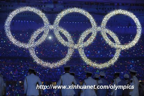 Photo taken on Aug. 8, 2008 shows the shining Olympic rings on a huge LED screen, proclaiming the arrival of the Olympiad, during the opening ceremony of the Beijing 2008 Olympic Games in the National Stadium, or the Bird's Nest, Beijing, capital of China. [Li Ga/Xinhua]