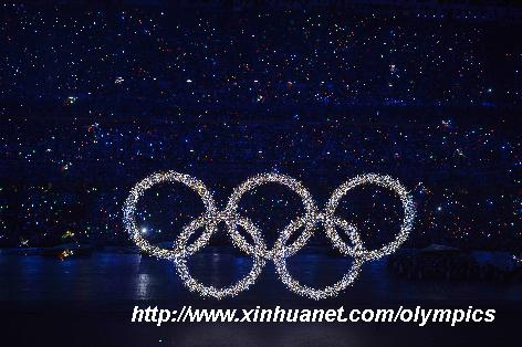 Photo taken on Aug. 8, 2008 shows the shining Olympic rings on a huge LED screen, proclaiming the arrival of the Olympiad, during the opening ceremony of the Beijing 2008 Olympic Games in the National Stadium, or the Bird's Nest, Beijing, capital of China. [Yang Lei/Xinhua]