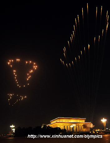 Photo taken on Aug. 8, 2008 shows the fireworks named the 'Footprints of History', symbolizing the pace of the successive summer Games, in the sky during the opening ceremony of the Beijing Olympic Games held in the National Stadium, also known as the Bird's Nest, in Beijing, China. [Zou Zheng/Xinhua]