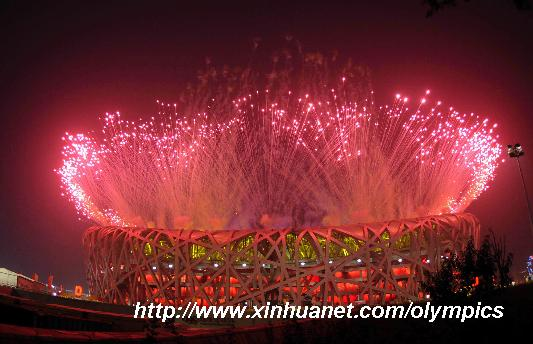 Photo taken on Aug. 8, 2008 shows the fireworks of the opening ceremony of the Beijing Olympic Games held in the National Stadium, also known as the Bird's Nest, in north Beijing, China. [Gaesang Dawa/Xinhua]