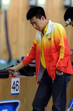 Pang Wei of China prepares to shoot during men's 10m air pistol qulification of Beijing Olympic Games at Beijing Shooting Range Hall in Beijing, China, August 9, 2008. Pang Wei won the gold medal in men's 10m air pistol final.