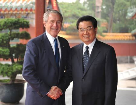 Chinese President Hu Jintao (R) shakes hands with US President George W. Bush at Zhongnanhai, compound of China's central authorities, in Beijing, China, Aug. 10, 2008. [Xinhua]