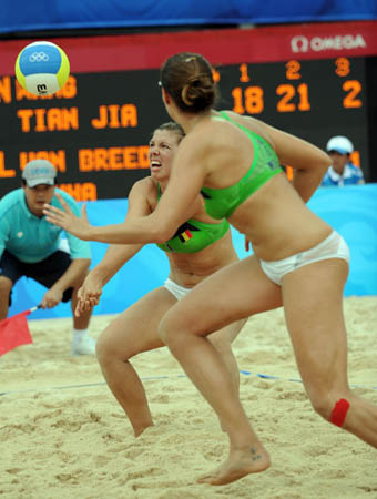 Liesbeth Mouha (front) and Liesbet van Breedam of Belgium competes against Wang Jie and Tian Jia of China during their match in women's preliminary pool A of the Beijing 2008 Olympic Games beach volleyball event in Beijing, China, Aug. 11, 2008. Wang Jie and Tian Jia of China won the match 2-1. (Xinhua/Sadat)