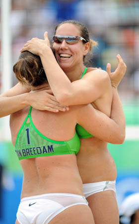 Liesbeth Mouha (R) and Liesbet van Breedam of Belgium celebrate a score during the match against Wang Jie and Tian Jia of China in women's preliminary pool A of the Beijing 2008 Olympic Games beach volleyball event in Beijing, China, Aug. 11, 2008. Wang Jie and Tian Jia of China won the match 2-1. (Xinhua/Sadat)
